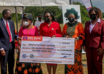 NICO Group officials: Vera Zulu, Ellen Nyasulu and Lillian Moyo, hand over cheque worth K2.5 million to Minister of Education, Hon. Agnes NyaLonje and Acting Executive Director of Shaping Our Future Foundation, Mr MacDuff Phiri