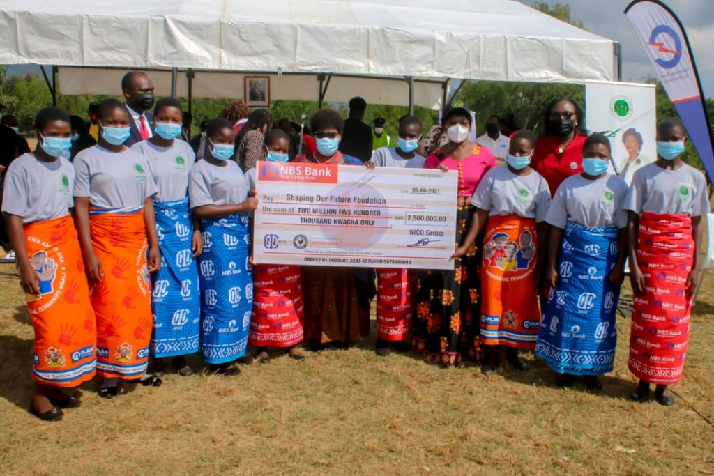 The beneficiaries under the mentorship program in Phalombe pose for a picture with Minister of Education, Hon. Agnes NyaLonje, MP for Phalombe South Constituency, Hon. Mary Mpanga, Acting Executive Director, SOFF, Mr. MacDuff Phiri and NBS Bank Chief Finance Officer, Mrs. Vera Zulu